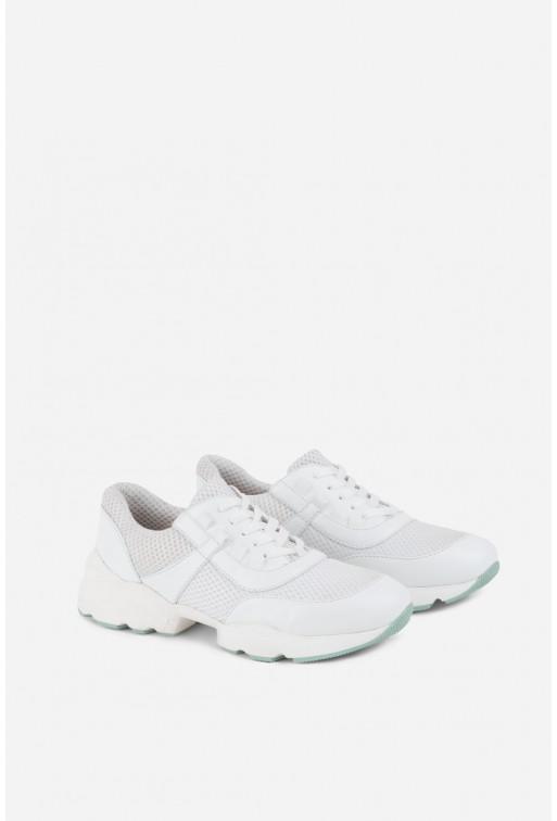 Кросівки білі шкіряні